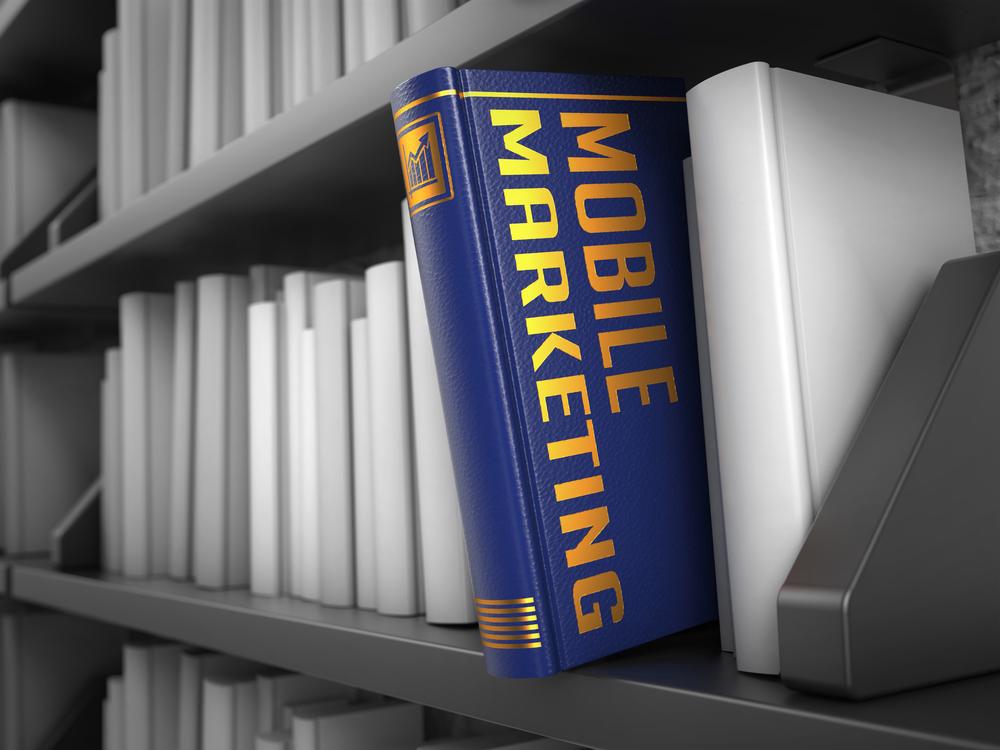 Mobile Marketing - Book on the Black Bookshelf between white ones.